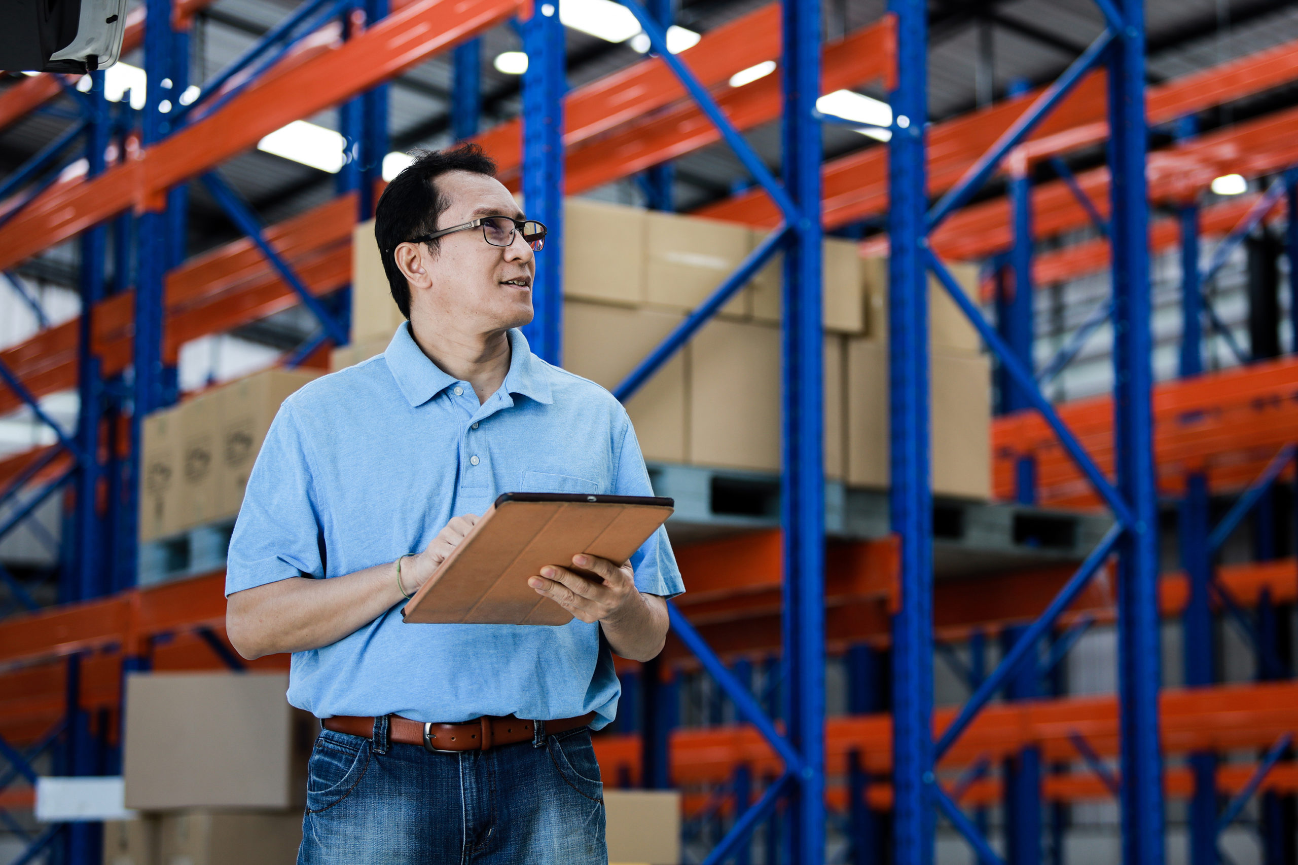 Man in warehouse representing supply chain process