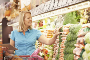 Image of women picking groceries with the help of the tablet